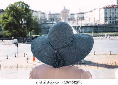 Girl in blue hat on Piazza Gran Madre di Dio in Turin Italy