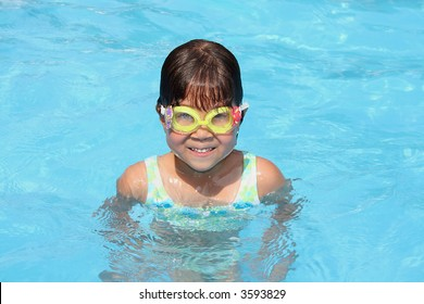 Girl in the blue pool