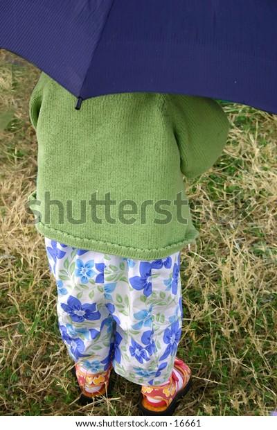 girl with blue umbrella