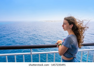 Girl in boat railing at Formentera Ibiza islands of Spain