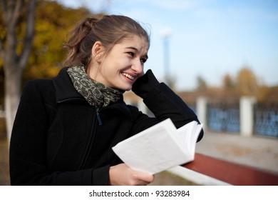 girl with book on bench