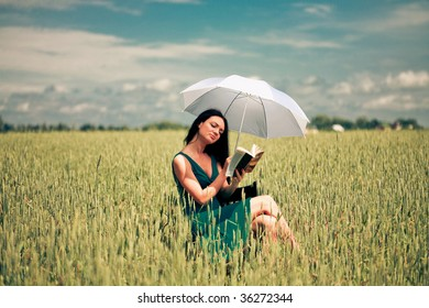 Girl with book under an umbrella