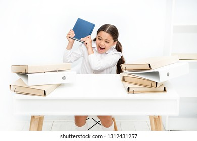 Girl bored pupil sit at desk with folders and books. Issues of formal education. Back to school concept. Kid cute tired of studying. Boring lesson. Boring task homework. Get rid of boring task.