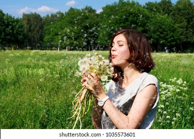 A girl and a bouquet of dandelions