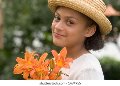 Girl with a bouquet of day lilies