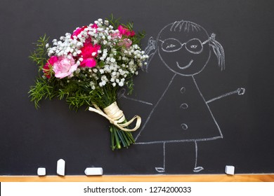 Girl with bouquet of flowers on blackboard teacher day abstract concept