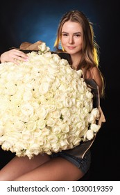 girl with a bouquet of white roses in the Studio