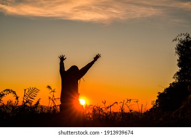 The girl bowed and prayed at sunset in the mountains, Eucharist Therapy Bless God Helping Repent Catholic Easter Lent Mind Pray. Christian Religion concept background. fighting and victory for god