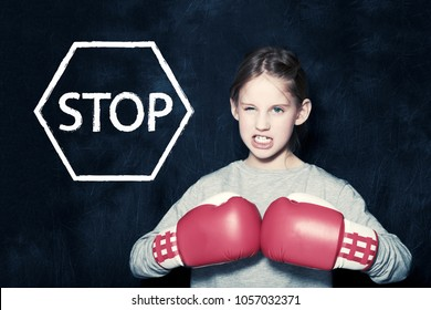 A girl with boxing gloves, children's rights and child protection, against violence and phidophilia, concept