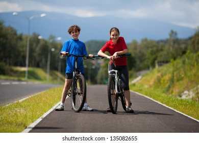 Girl and boy biking