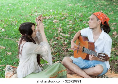 girl and boy hippies in a sunny day outdoor