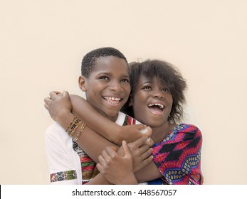Girl and boy hugging each other and laughing