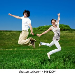 Girl and boy are jumping