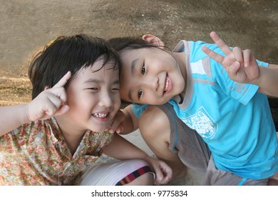 Girl and boy laughing and playing happily