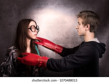 Girl and boy with  lobster claw. Difficult teenager's relationship concept.