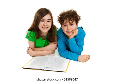 Girl and boy lying, reading book
