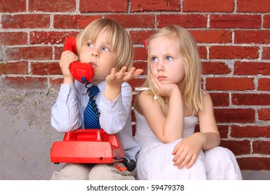 Girl and boy with the phone. Relationship and communication
