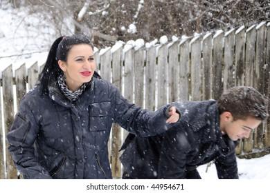 girl and boy playing in winter season
