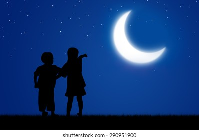 Girl and boy point the moon in the night