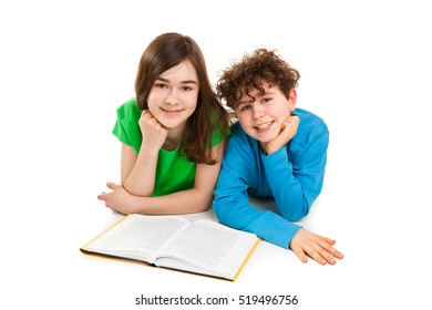 Girl and boy reading book, lying