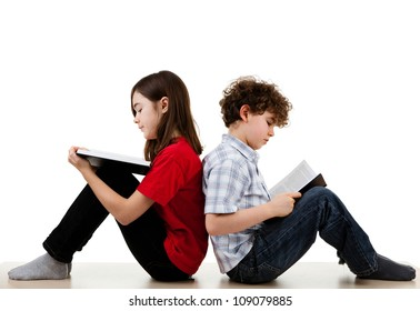 Girl and boy reading books on white background