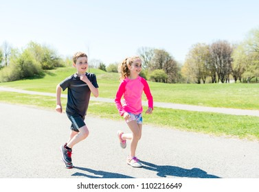 Girl and boy running, outside and having fun