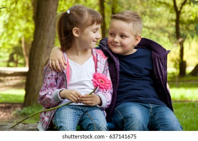 girl and boy. small children spend time in nature. relationships between children