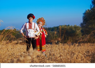 Girl and boy together  in Russian folk costume
