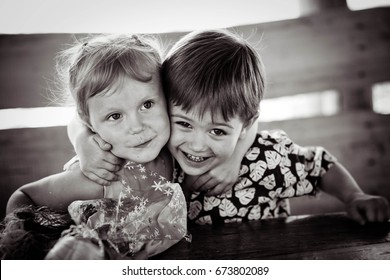 The girl with the boy wriggle. Monochrome. Concept of friendship