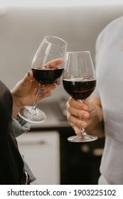 Girl and boyfriend knocking over wine