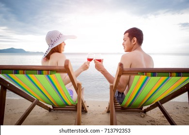 Girl with boyfriend lover Honeymoon at the beach happily in the summer.