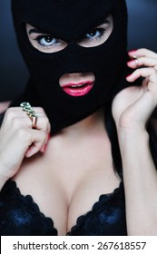 girl in bra and balaclava - color photo in studio of a psycho girl