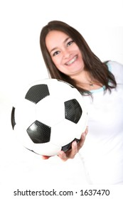 girl with braces holding a soccer ball