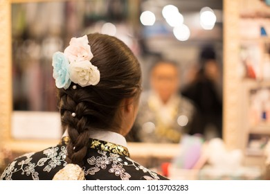 A Girl and Braided Hair in Front of Cosmetic Mirror while Preparing for Event. Hair Fashion Event