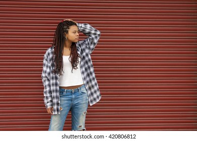 girl with braids on the street