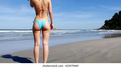 Girl with Brazilian Bikini at the summer beach in Brazil in Slow Motion