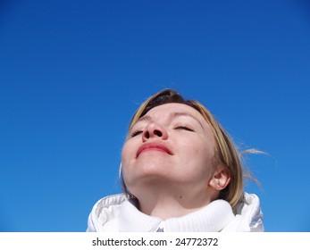 girl breathes air in mountain