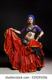 The girl in bright east dancing dress Belly Dance ATS