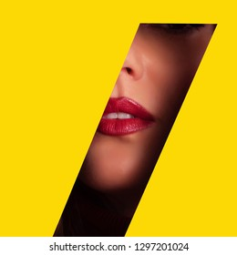 Girl with bright make up, red lipstick looking through hole in yellow paper. Make up artist, beauty concept. Square crop. Cosmetics sale. Beauty salon advertising banner with copy space.