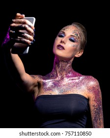girl with bright makeup art in glitter on a black background