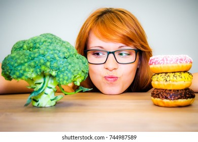 Girl with broccoli and donuts