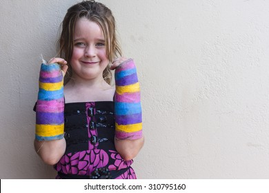 Girl Broken Arms Young girl child broken fracture wrist arms in plaster color casts