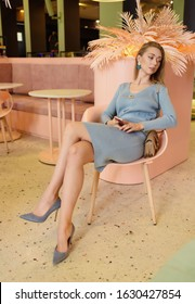 Girl in brought blue clothing, a beautiful interior. Fashion shooting.
