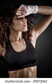 girl with brown hair sweating after workout