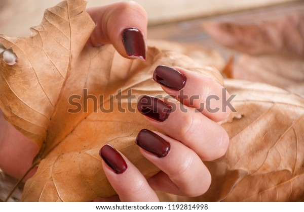 girl-brown-manicure-on-finger-600w-11928