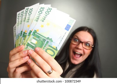 the girl the brunette wearing spectacles holds a lot of money