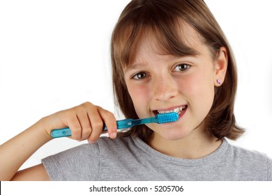 Girl brushing her teeth against white background