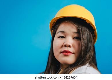 Girl with the builder helmet