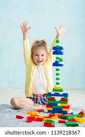 the girl built a tower of cubes. The joy of games