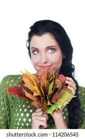 Girl with bunch of maple leaves on isolated white